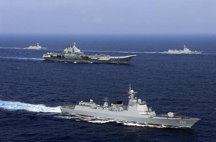 China's aircraft carrier Liaoning (C) takes part in a military drill of Chinese People's Liberation Army (PLA) Navy in the western Pacific Ocean, April 18, 2018. Photo: Reuters/Stringer