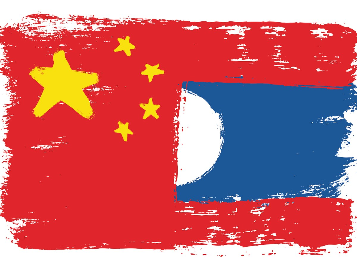 Image of a Chinese flag subsuming a Laos flag. Image: iStock/Getty Images
