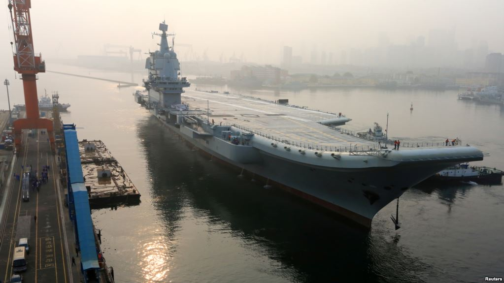 China's first domestically  manufactured aircraft carrier, known only as 'Type 001A,' leaves port in the northeast city of Dalian on May 13. Photo: Reuters