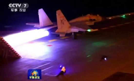 The glowing afterburner of a J-15 fighter jet is seen aboard the Chinese carrier Liaoning during a recent nighttime training. Photo: China Central Television screen grab