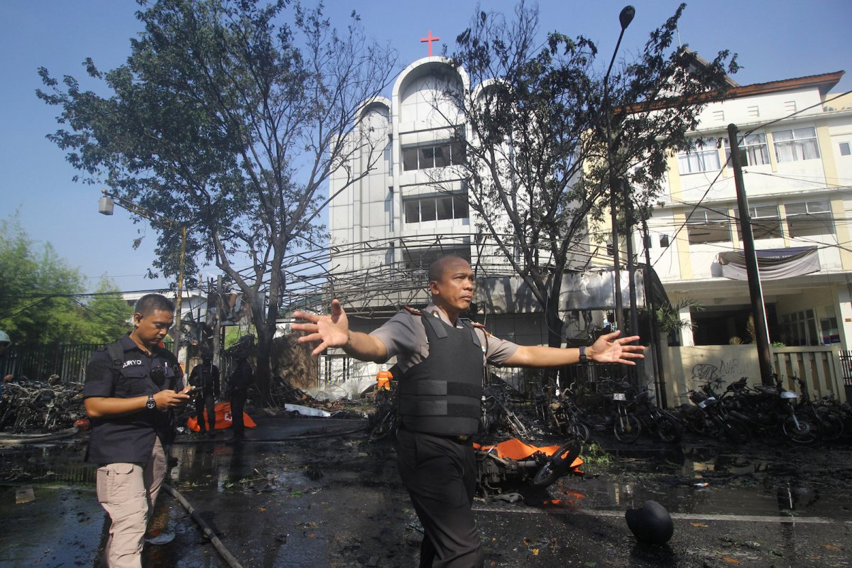 Police stand guard the site of a bomb blast at the Pentecost Church Central Surabaya, in East Java, Indonesia on May 13, 2018.  Photo: Antara Foto via Reuters/Moch Asim