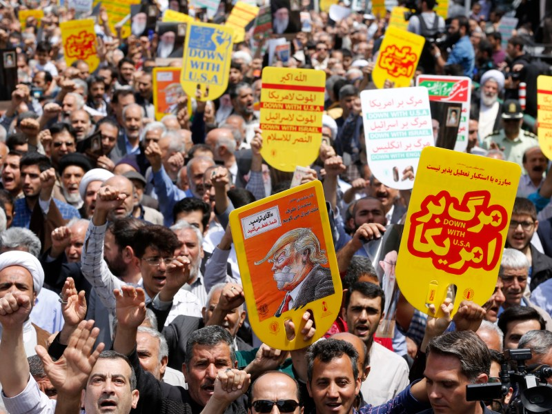 Iranians hold anti-US placards and shout slogans during a rally after Friday prayers in the capital Tehran on May 11, 2018, after President Trump withdrew the US from a nuclear accord signed in 2015. Photo: AFP