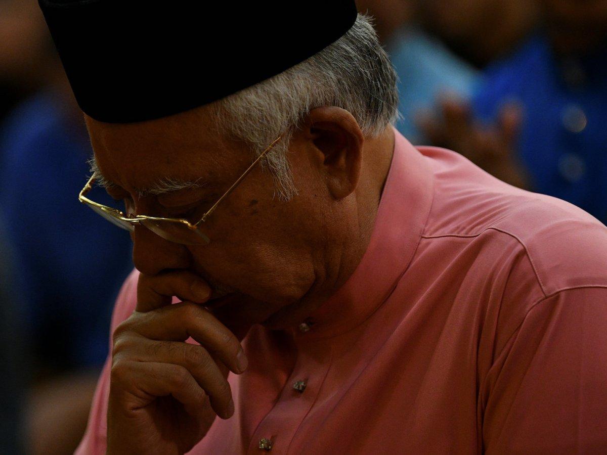 Malaysia's former Prime Minister Najib Razak prays before he attends the United Malays National Organisation (UMNO) 72th anniversary celebrations in Kuala Lumpur, Malaysia May 11, 2018. Photo: Reuters/Stringer