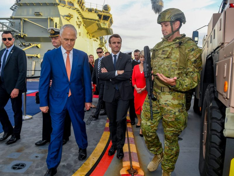 French President Emmanuel Macron (C) and Australian Prime Minister Malcolm Turnbull visit HMAS Canberra at Garden Island in Sydney on May 2, 2018. Photo: AFP/Brendan Esposito