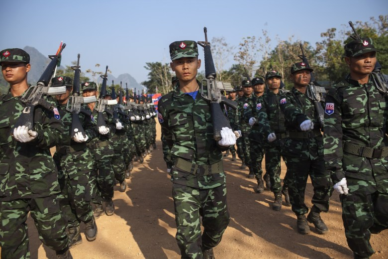 This picture taken on January 31, 2015 shows soldiers from the Karen National Liberation Army (KNLA)'s Seventh Brigade parading as part of celebrations marking the 66th Karen Revolution Day at their headquarters in Myanmar's eastern Kayin state. The KNLA is the armed wing of the Karen National Union (KNU) and is believed to have between 3,000 to 5,000 active fighters in its ranks. The KNU signed a ceasefire agreement with Myanmar's central government in 2012 but fighting has continued sporadically in several border areas, undermining the authorities' hopes to reach a nationwide ceasefire with all of the country's armed ethnic groups ahead of the 2015 general elections scheduled for the end of the year.  AFP PHOTO/KC Ortiz / AFP PHOTO / KC Ortiz
