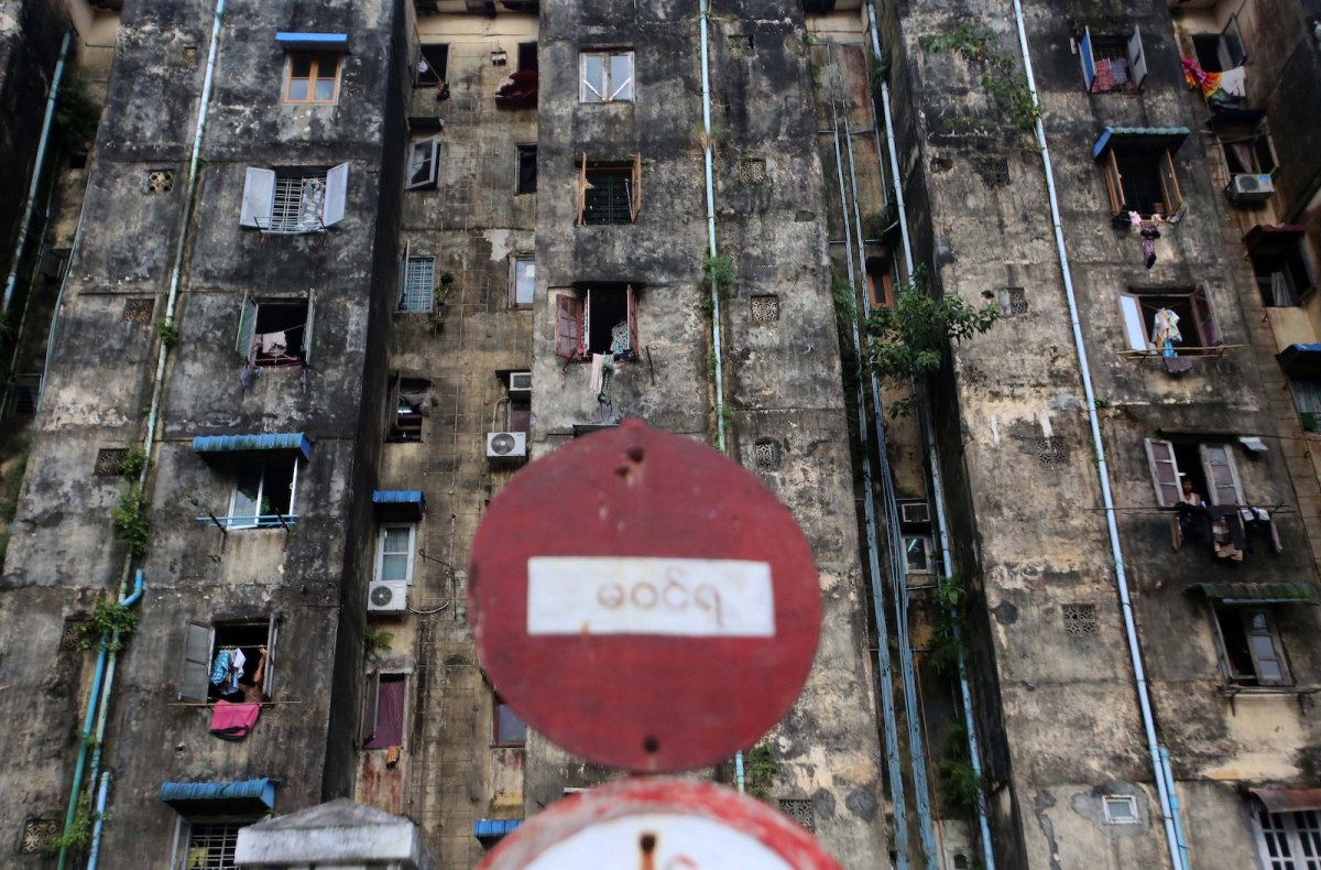 Old apartment blocks in downtown Yangon. Demand for property in Yangon had surged with hopes of an economic boom that has not materialized. Photo: AFP/Ye Aung Thu