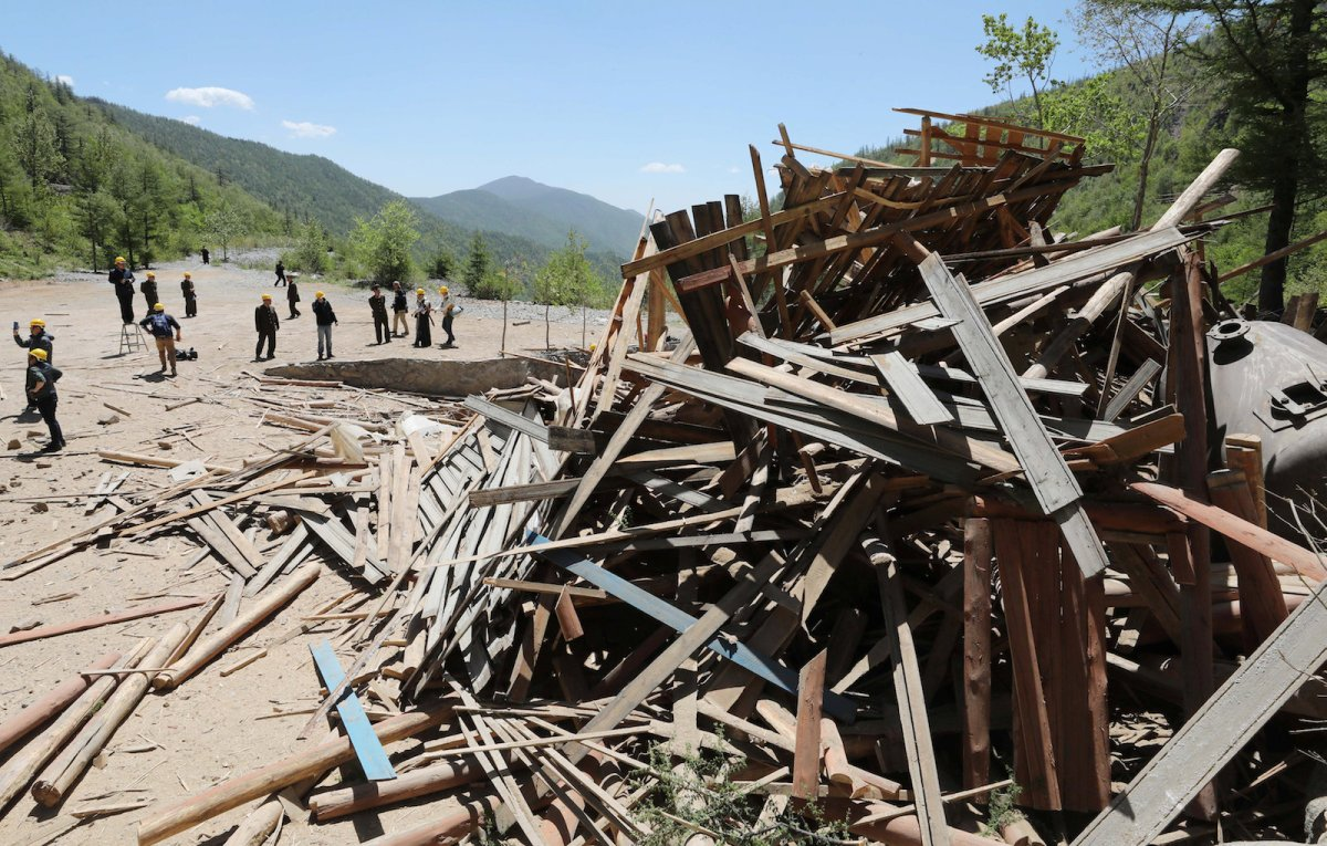 Journalists and North Korean officials look around the dismantled site at the Punggye-ri nuclear test facility. Photo: Reuters