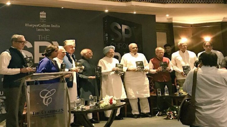 Former Indian PM Manmohan Singh, center in turban, is seen at the release of the book, 'Spy Chronicles' in New Delhi. Photo: Courtesy Twitter