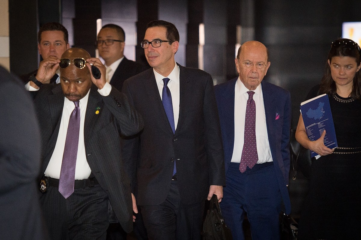 US Treasury Secretary Steven Mnuchin, center, and US Commerce Secretary Wilbur Ross, second right, walk through a hotel lobby in Beijing. Photo: AFP/Nicolas Asfouri