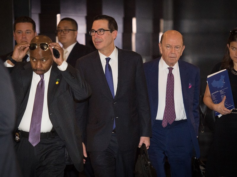 US Treasury Secretary Steven Mnuchin, center, and US Commerce Secretary Wilbur Ross, second right, walk through a hotel lobby in Beijing. Photo: AFP/Nicolas Asfouri