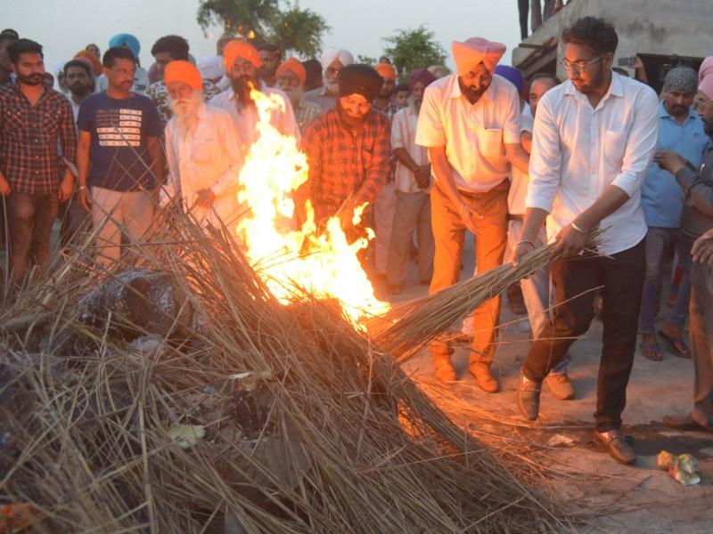 The son of an Indian Central Reserve Police Force officer lights his funeral pyre in Sathiala village, 45km from Amritsar, on April 25, 2017. Raghbir Singh was killed in an attack by about 300 Maoists in Chhattisgarh. He was one of 25 troops killed in an ambush. They were security for the building of a new road opposed by the Maoists. Photo: AFP/ Narinder Nanu