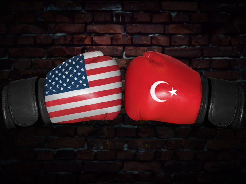A boxing match. Confrontation between the USA and Turkey. Turkish and American national flags on Boxing gloves. Sports competition between the two countries. Concept of the foreign policy conflict. Photo: iStock