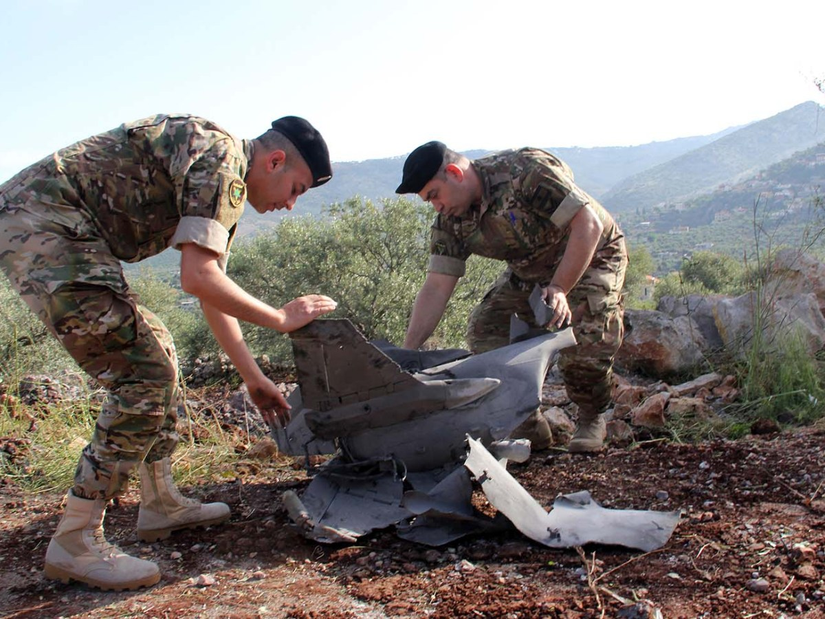 Lebanese soldiers inspect remains of a surface to air missile that landed in the Lebanese village of Hebarieh, early on May 10, 2018. Photo: AF/Ali Dia