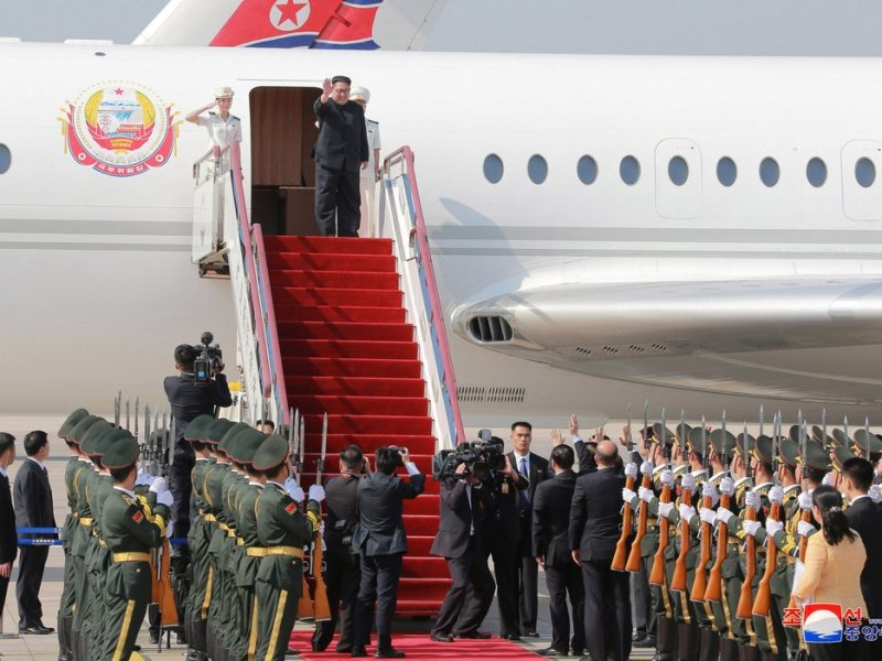 North Korean leader Kim Jong-un is seen disembarking from an Ilyushin Il-62 plane after arriving in Dalian on Monday. Photo: Korean Central News Agency, via Reuters