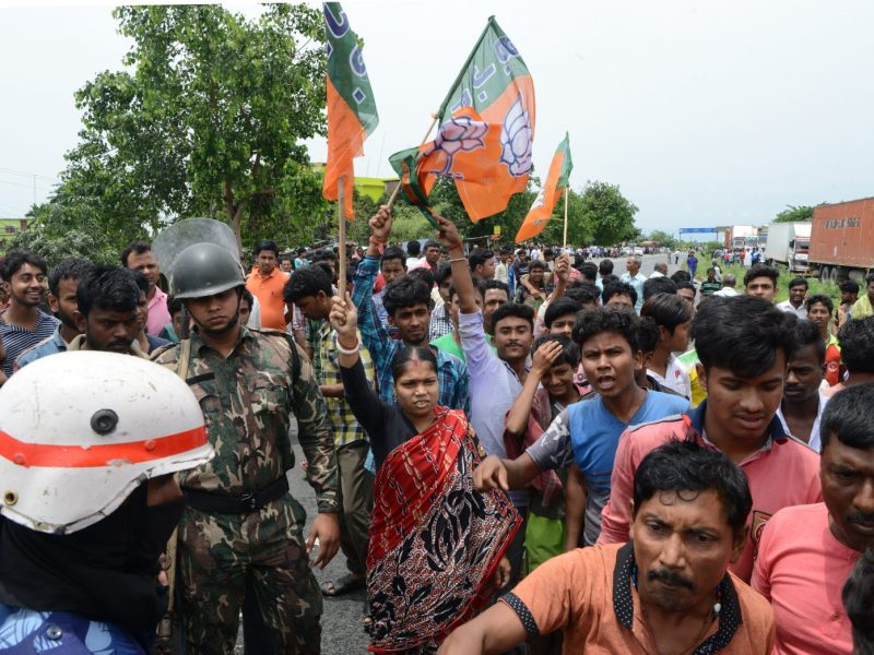 Bharatiya Janata Party supporters chant slogans as they block Highway 31 during a protest over the ruling Trinamool Congress party at Chopra village in the North Dinajpur, West Bengal. Photo: AFP / Diptendu Dutta