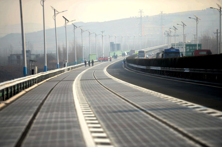 Solar panels are paved on the world's first photovoltaic highway to be opened to traffic in Jinan city, east China's Shandong province. Photo: AFP
