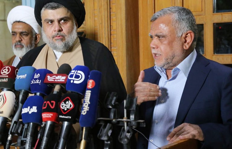 Hadi al-Amiri (right) speaks during a joint press conference with Shiite cleric Muqtada al-Sadr. Photo: Anadolu via AFP/Muqtada al-Sadr Press Office
