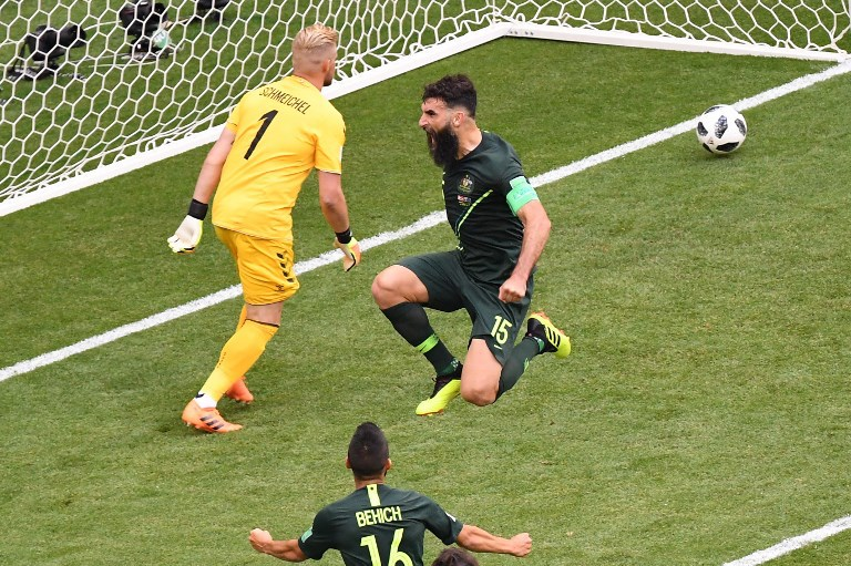 Australian midfielder Mile Jedinak (center) celebrates  after scoring a penalty kick  during the World Cup Group C match between Denmark and Australia at the Samara Arena in Russia on June 21, 2018. Photo: AFP / Emmanuel Dunand