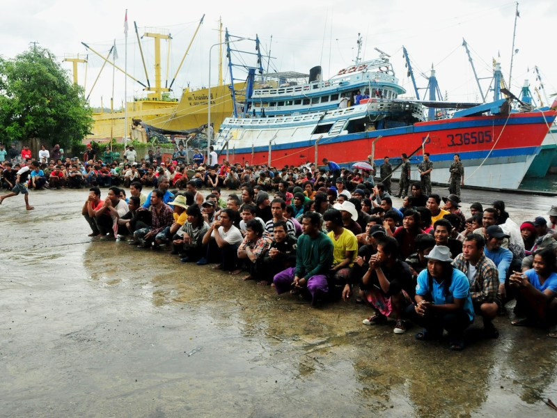 Hundreds of rescued foreign fishermen, mostly from Myanmar and Thailand, are gathered by Indonesia's illegal fishing taskforce and Thai officials at an Indonesian fishing firm on April 3, 2015, in remote Benjina Island. Photo:  AFP/ Ugeng Nugroho/ Ministry of Fishery