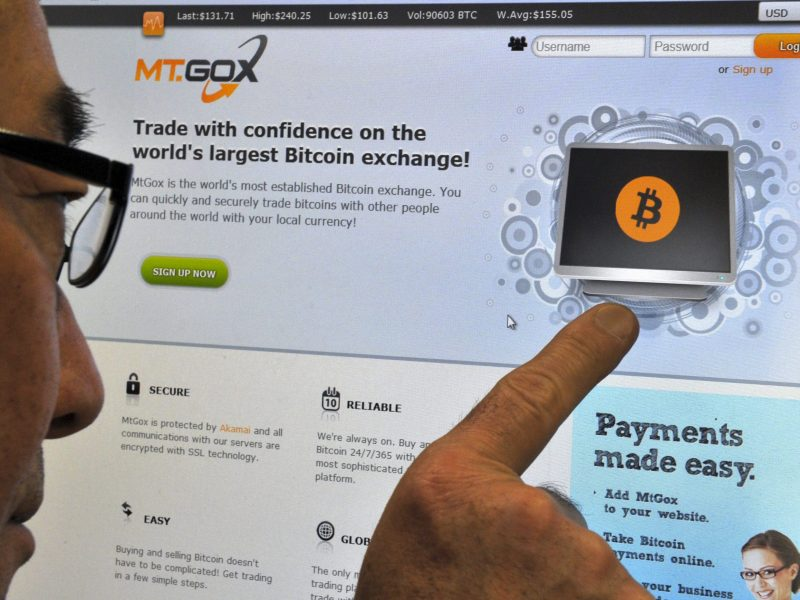 A man looks at the Bitcoin exchange website of Mt Gox in Tokyo in 2014 after it lost 650,000 Bitcoins via a hack. At the time, Mt Gox was the world's largest virtual currency broker. Photo: AFP/Yoshikazu Tsuno
