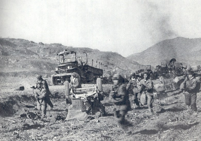 "CPVA troops storm through the ambush of the US 2nd Infantry Division in ""The Gauntlet"" at Kunu-ri Pass - the worst battlefield defeat suffered by the US Army since 1945. Photo: Paik Sun-yeop"