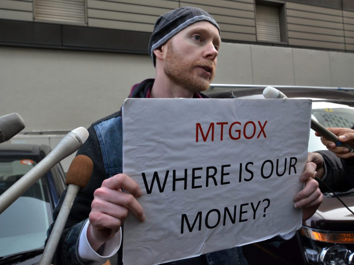 A Bitcoin trader protests against the Mt. Gox exchange in Tokyo in February, 2014. Two trading 'bots' were later proved to have significantly increased and manipulated trade at the now defunct Bitcoin exchange. Photo: AFP/Yoshikazu Tsuno