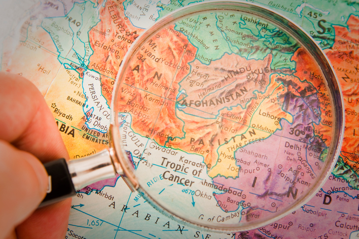 Afghanistan, Pakistan and surrounding countries  on retro globe underneath a magnifying glass. Image: iStock