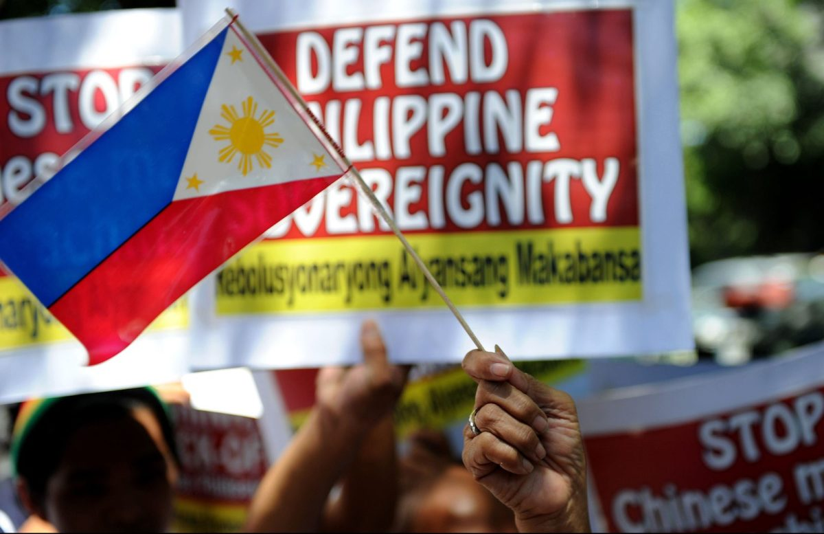 Philippine activists hold a protest in front of the Chinese Consular Office in Makati, the financial district of Manila, condemning what they say is China's intrusions into the Scarborough Shoal, known to the Chinese as Huangyan, in a file photo: Photo: AFP/Noel Celis