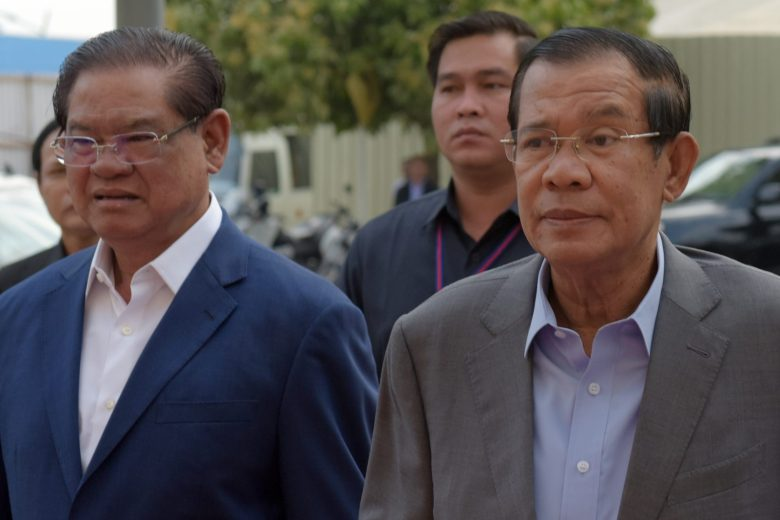Hun Sen (R) with Interior Minister Sar Kheng, who some analysts say could become the next prime minister. Photo: AFP/Tang Chhin Sothy