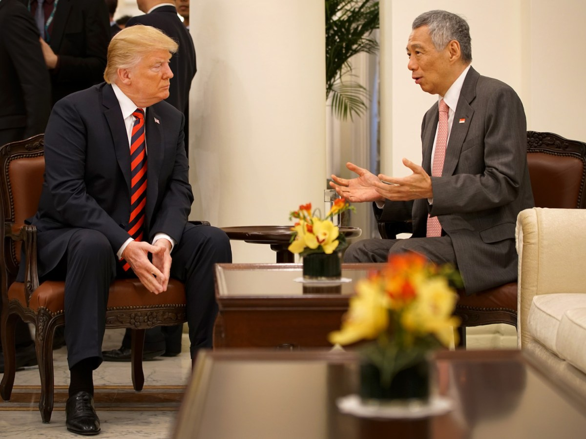 US President Donald Trump, left, listens to Singapore Prime Minister Lee Hsien Loong during his visit to The Istana, the official residence of the PM in the city-state, prior to the historic summit on Tuesday. Photo: AFP/ handout from Singapore Communications and Information Ministry