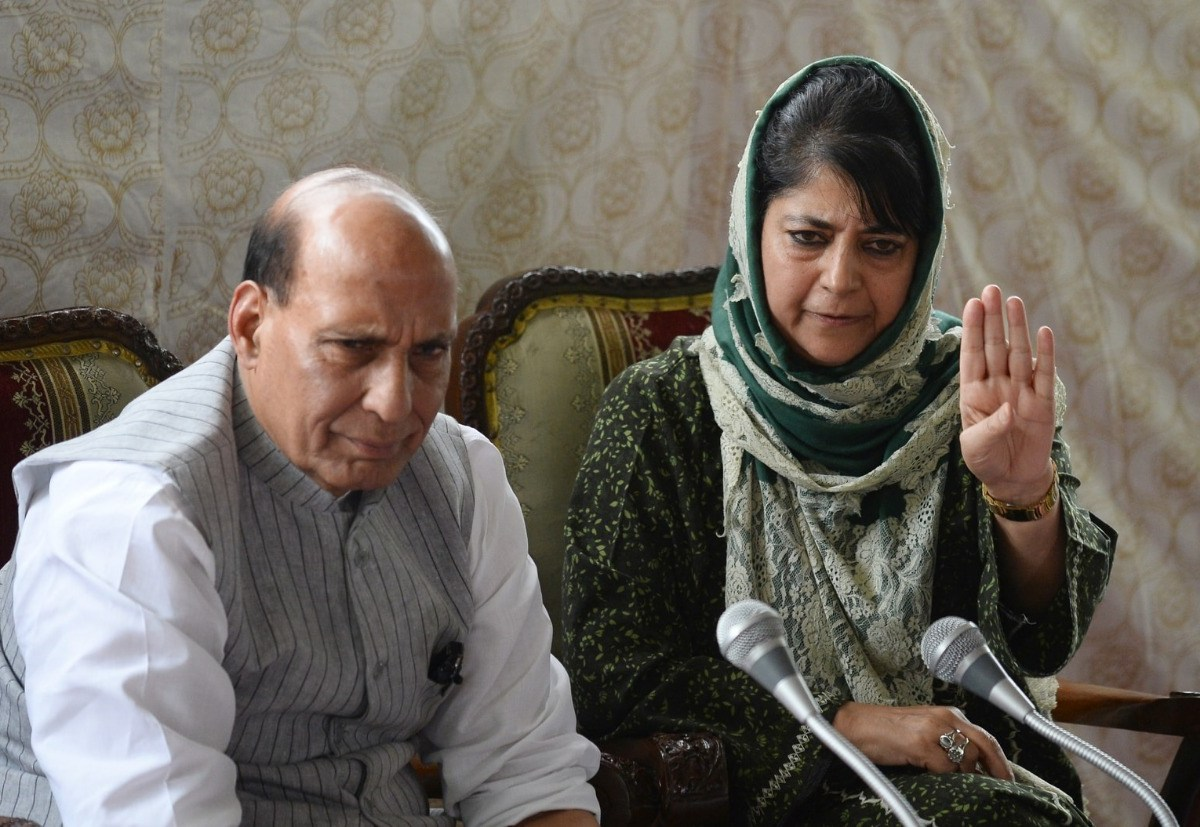 File photo of Union Home Minister Rajnath Singh and now sacked Kashmir Chief Minister Mehbooba Mufti at a press conference in Srinagar. Photo: AFP
