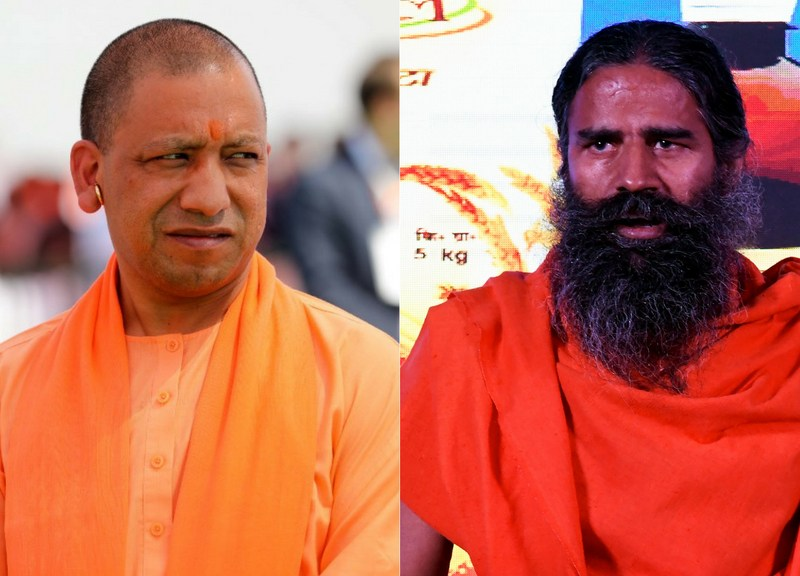 Uttar Pradesh Chief Minister Yogi Adityanath (L) and yoga Guru Baba Ramdev. Photos: AFP