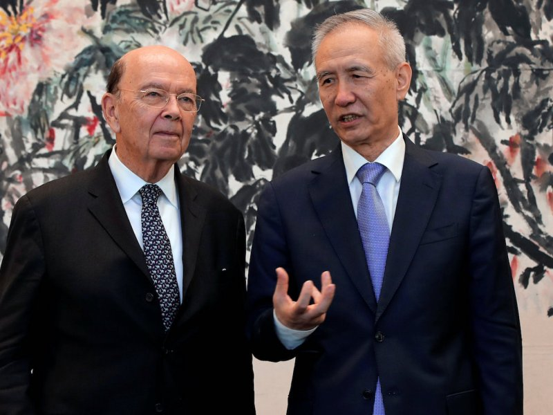 US Commerce Secretary Wilbur Ross chats with Chinese Vice-Premier Liu He in Beijing. Photo: Reuters / Andy Wong