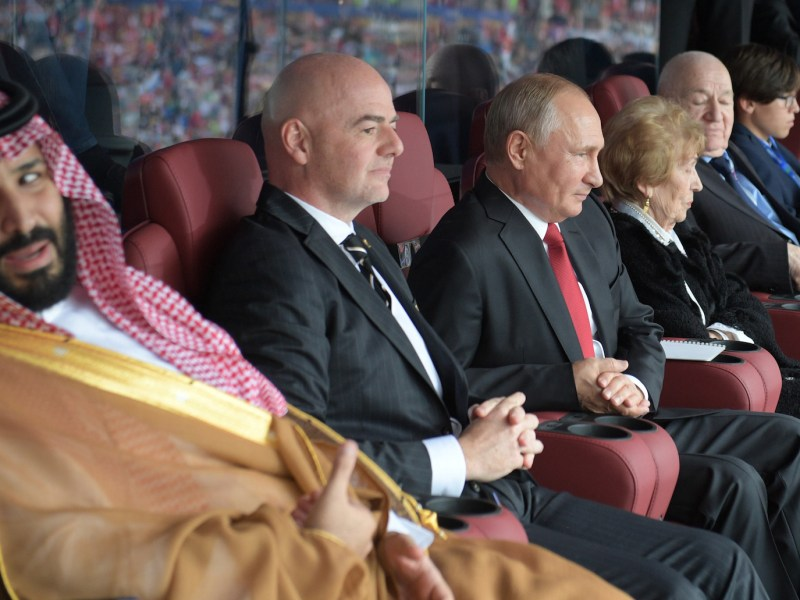 Saudi Crown Prince Mohammed bin Salman, left, FIFA president Gianni Infantino and Russian President Vladimir Putin watch the ceremony prior to the Russia 2018 World Cup Group A football match between Russia and Saudi Arabia at the Luzhniki Stadium in Moscow on June 14, 2018. Photo: AFP/ Sputnik/ Alexey Druzhinin