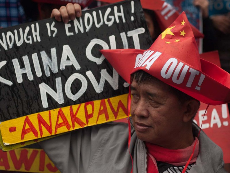 A protester holds a placard during a rally coinciding the Philippines' 120th Independence Day at the Chinese consulate in Manila, Philippines on Tuesday, 12 June 2018. Protesters staged protests outside the Chinese consulate and the US embassy on the Philippines' 120th Independence Day to protest China's bullying and militarization in the West Philippine Sea, and the United States' alleged meddling in the country's domestic affairs. According to reports, a recent video allegedly showed China's coast guard boarding a fishing boat and taking their catch. (Photo by Richard James Mendoza/NurPhoto)