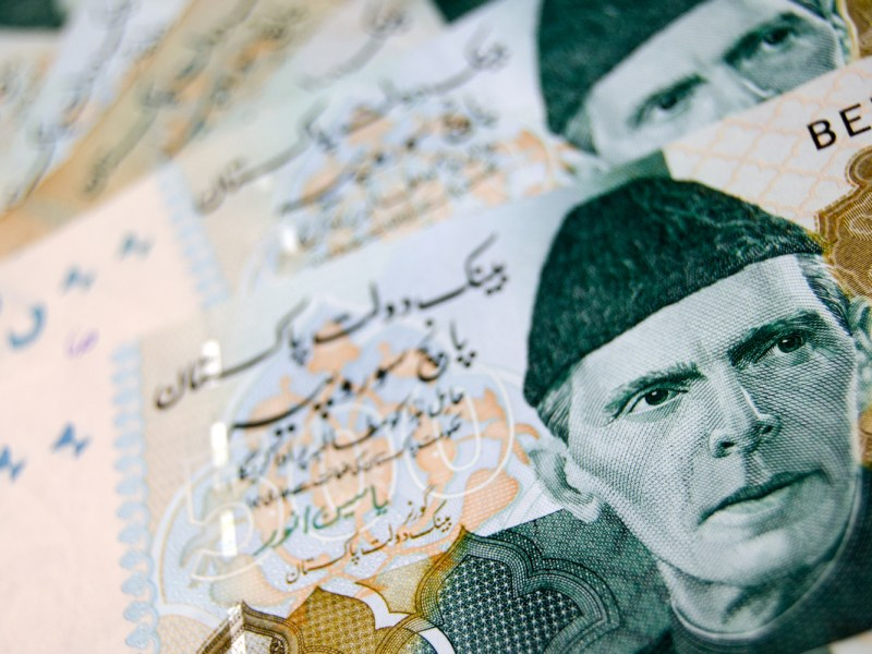 A fan of 500 rupee banknotes from Pakistan showing the face of Muhammad Ali Jinnah in national dress. Photo: iStock