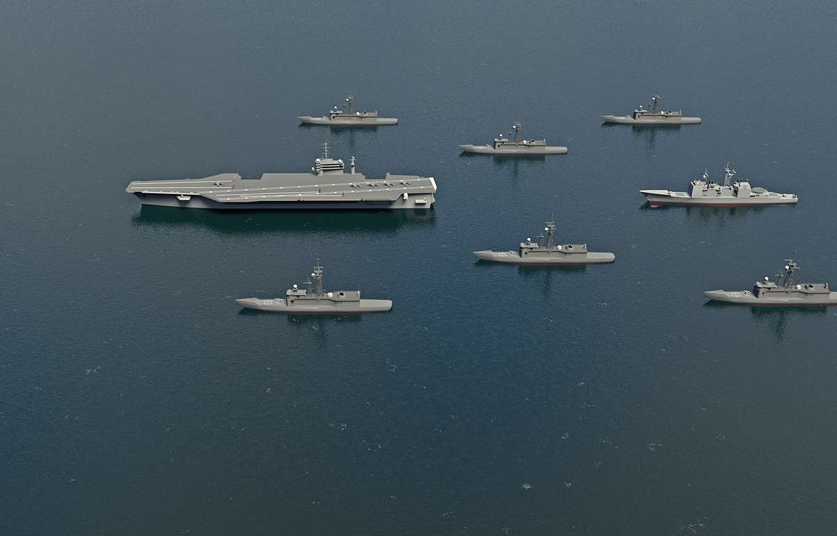 American Aircraft Carrier with destroyers and a cruiser in the Pacific Ocean towards North Korea. 3d rendering. Photo: iStock