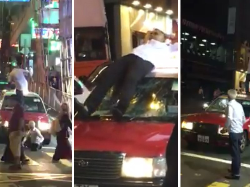 A drunk man was seen standing on a taxi in Wan Chai. Photo: Syl Lam@Facebook