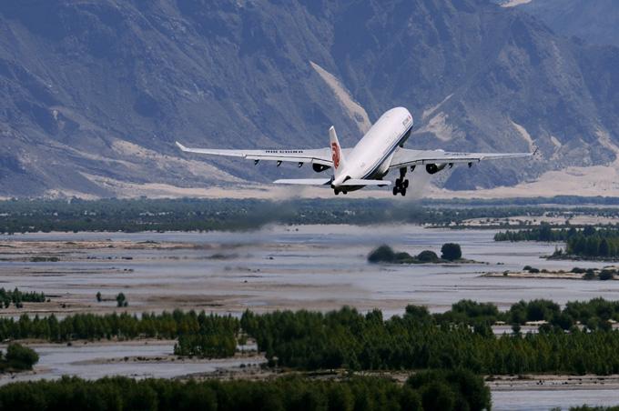 An Air China plane flies over Lhasa, Tibet. Photo: Handout