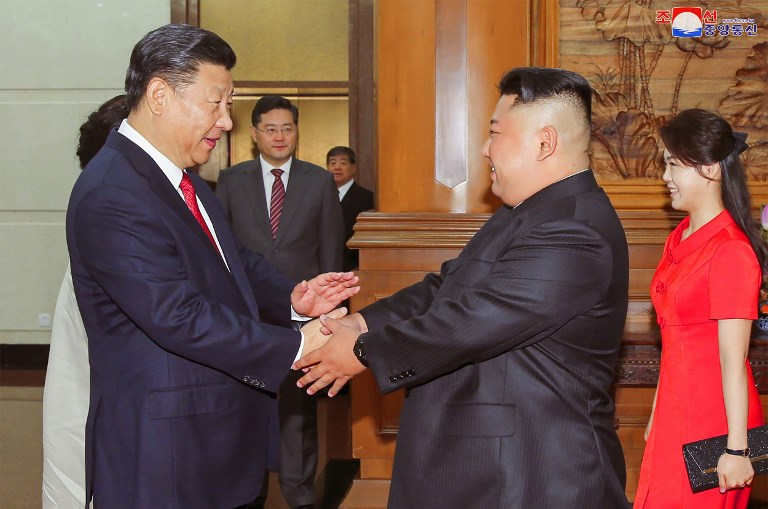 North Korean leader Kim Jong-un with Chinese President Xi Jinping. Photo: AFP