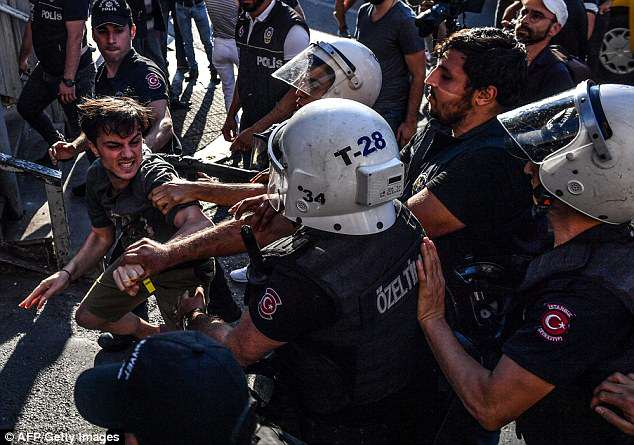 Riot police break up a Pride march in Istanbul on Sunday. Photo: AFP