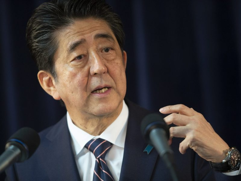 Japanese Prime Minister Shinzo Abe will be happy with the revised economic data. Photo: AFP/ Geoff Robins