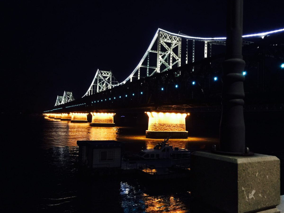 After dusk, the bridge from Dandong, China, to Sinuiiju, North Korea, extends into darkness south of the Yalu. Photo: Andrew Salmon/Asia Times