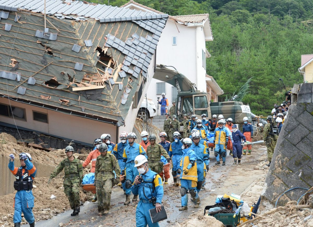 Rescuers conduct a search for missing people in Kumano Town in Hiroshima Prefecture on July 9, 2018. The record rainfall has caused widespread flooding and landslides in the central and western part of Japan. Photo: AFP/The Yomiuri Shimbun