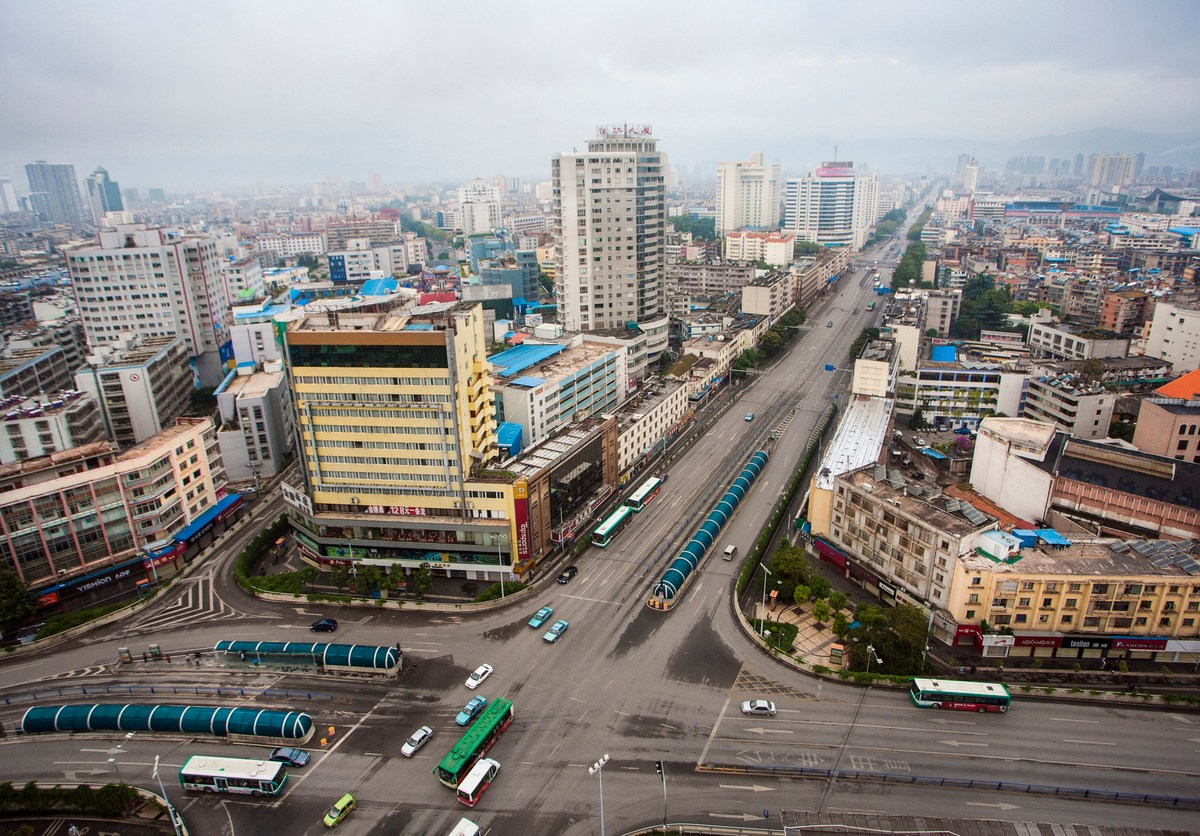 Aerial view of Kunming skyline in fog with empty streets. Photo: iStock