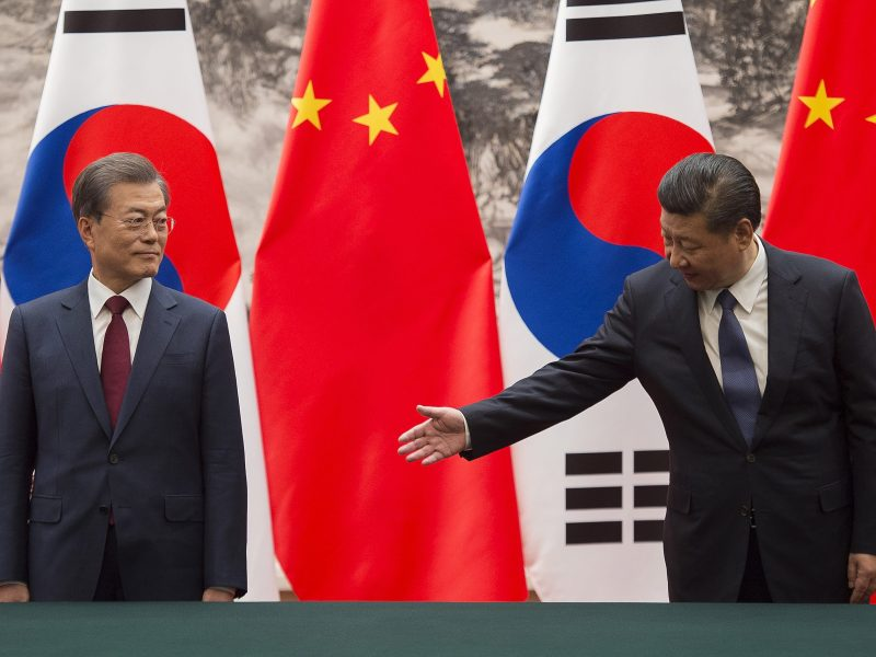 South Korean President Moon Jae-in (L) and Chinese President Xi Jinping during a signing ceremony at the Great Hall of the People in Beijing on December 14, 2017. Photo: AFP/Nicolas Asfouri