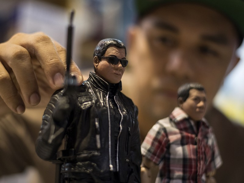 "Miniature dolls of Philippine President Rodrigo Duterte as ""The Terminator"" (L)  on display at TOYCON 2018 toy, hobby and collectible convention, Manila, June 8, 2018. Photo: AFP/Noel Celis"