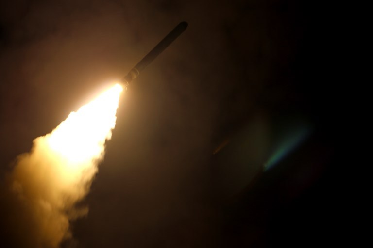 In this image released by the US Department of Defense the guided-missile cruiser USS Monterey fires a Tomahawk land attack missile on April 14, 2018, against Syria. Photo: AFP / US Department of Defense / Kallysta Castillo
