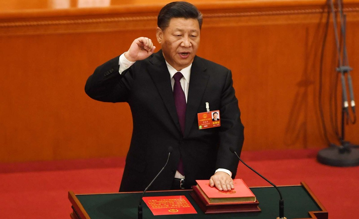 China's President Xi Jinping speaks at the fifth plenary session of the first session of the 13th National People's Congress (NPC) at the Great Hall of the People in Beijing on March 17, 2018. Photo: AFP/Greg Baker