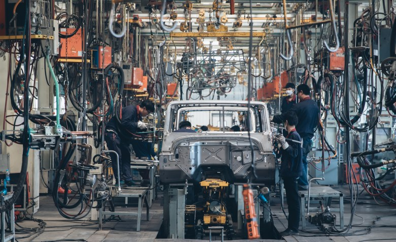 Workers in an automobile factory in Beijing. Photo: iStock